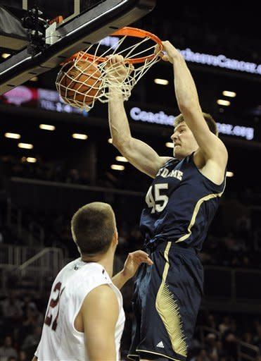 Notre Dame's Jack Cooley (45) dunks a basket over St. Joseph's Halil Kanacevic in the first half of the Coaches vs. Cancer Classic basketball game on Friday, Nov., 16, 2012, at Barclays Center in New York. (AP Photo/Kathy Kmonicek)