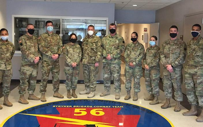 Major Francis (in white face mask) benefited from a reciprocal scheme that sees about 30 US Reservists serving in Britain - MoD