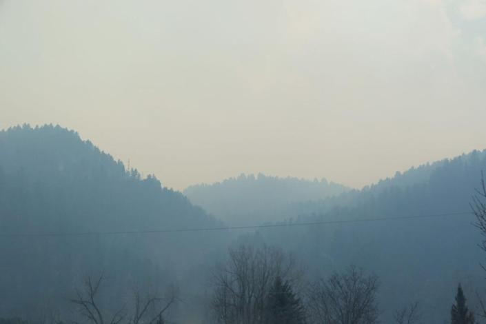 Smoke from Schroederfire heads south across the Black Hills on Monday. The fire began about four miles west of Rapid City, and strong winds sent southeast on Monday.