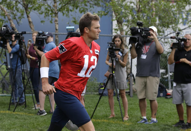 Tom Brady, meet Tom and Brady: the Patriots' quarterback met twins bearing his name this week at training camp. (AP)