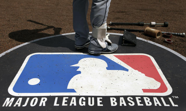 FILE - In this April 24, 2013, file photo, Cleveland Indians second baseman Jason Kipnis stands on the Major League Baseball logo that serves as the on deck circle during the first inning of a baseball game between the Chicago White Sox and the Indians, in Chicago. Major League Baseball rejected the players' offer for a 114-game regular season in the pandemic-delayed season with no additional salary cuts and told the union it did not plan to make a counterproposal, a person familiar with the negotiations told The Associated Press. The person spoke on condition of anonymity Wednesday, June 3, 2020, because no statements were authorized.(AP Photo/Charles Rex Arbogast, File)