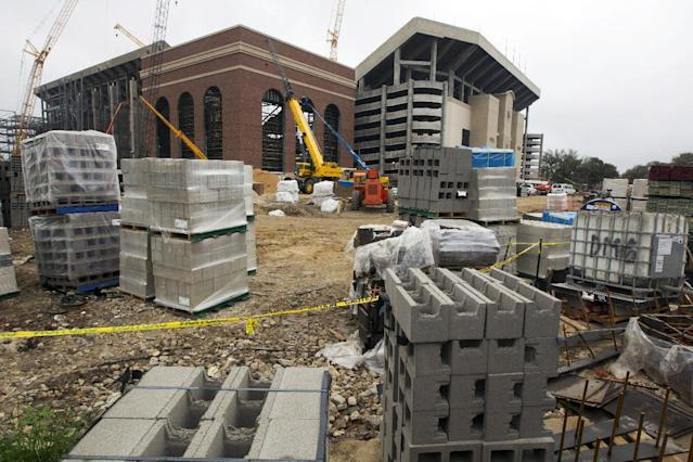 Construction material sits outside as a crew worka on the redevelopment of Kyle Field in College Station, Texas, Thursday, March 27, 2014. (AP Photo/Patric Schneider)