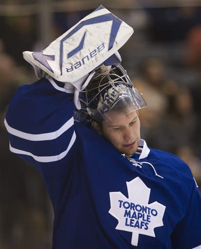Toronto Maple Leafs goalie James Reimer looks down after allowing two goals to The Washington Capitals early in first-period NHL hockey game action in Toronto, Saturday, Feb. 25, 2012. (AP Photo/The Canadian Press, Nathan Denette)