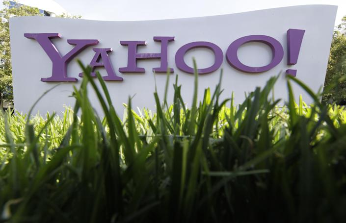 FILE - In this May 20, 2012 file photo, a Yahoo sign stands outside the company's offices in Santa Clara, Calif. A report in the tech blog AllThingsD says Facebook and Yahoo have reached a deal that settles their patent squabbles and expands their licensing and advertising partnership, according to reports, Friday, July 6, 2012. (AP Photo/Paul Sakuma, File)