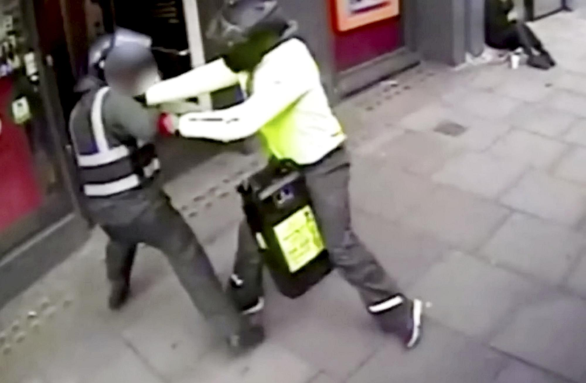 Dramatic moment security guard reverses into 'smash and grab' moped robbers behind string of raids in London