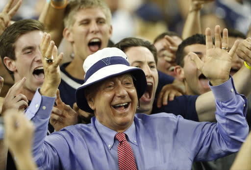 FILE - In this April 4, 2016, file photo, sportscaster Dick Vitale poses with Villanova fans before the NCAA Final Four tournament college basketball championship game between Villanova and North Carolina in Houston. Vitale didn't know if he would reach this year's $5 million goal of raising money for pediatric cancer research due to the coronavirus pandemic. It turns out he has met his goal and then some. Vitale's annual gala has already reached $7 million going into Friday's event, which will be virtual this year. (AP Photo/Eric Gay, File)