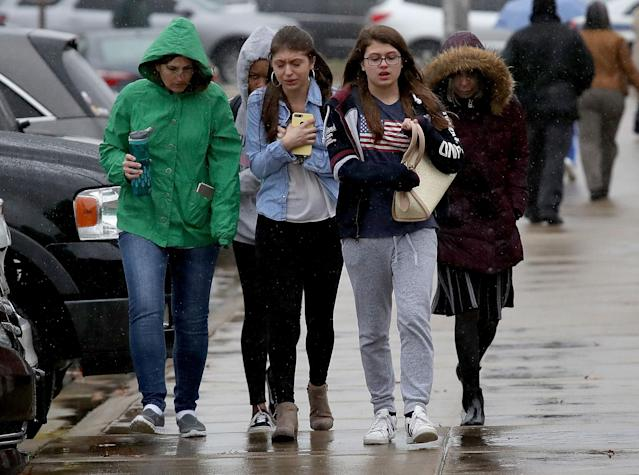<p>Students from Great Mills High School walk to meet their parents at Leonardtown High School following a school shooting at Great Mills High School March 20, 2018 in Leonardtown, Maryland. (Photo: Win McNamee/Getty Images) </p>