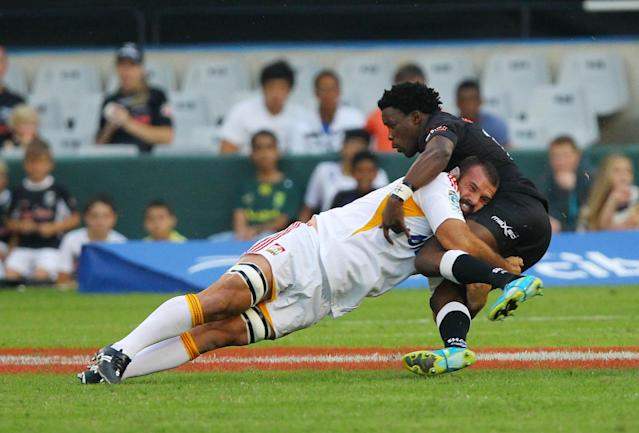New Zealand Waikato Chiefs' Lwazi Mvovo (R) is tackled by with Durban Sharks' Alex Bradley during a Super 15 rugby union match at the Mr Price Kings Park Rugby Stadium on April 21, 2012. AFP PHOTO (Photo credit should read -/AFP/Getty Images)