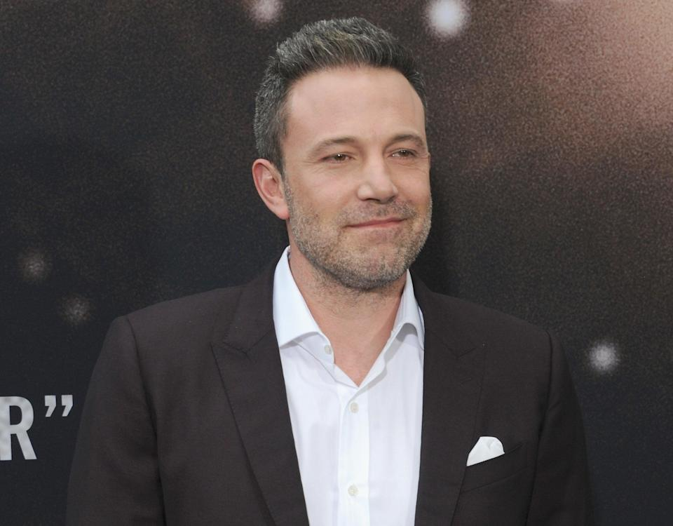 Ben smiles while attending a premiere