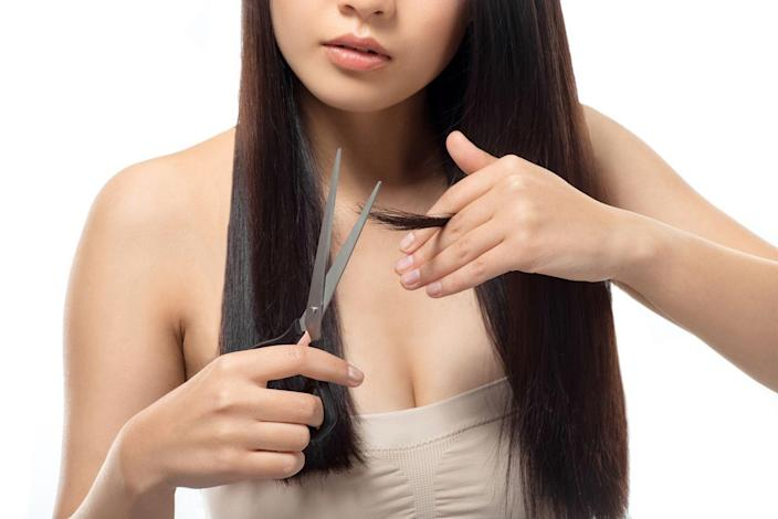 """<p>Don't freak out. I'm not talking about DIY-ing a dramatic new style or anything like that. But you can cut down the number of trips you take to the salon each year if you do some maintenance in between appointments. Just make sure you have the right tools (this is super important!) and follow our <a href=""""https://www.cosmopolitan.com/style-beauty/beauty/a29858128/how-to-cut-your-own-hair/"""" rel=""""nofollow noopener"""" target=""""_blank"""" data-ylk=""""slk:guide"""" class=""""link rapid-noclick-resp"""">guide</a>. </p>"""