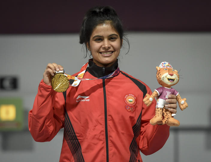 BUENOS AIRES, ARGENTINA - OCTOBER 09: Manu Bhaker of India shows her Gold medal after competing in 10m Air Rifle Women during Day 3 of Buenos Aires 2018 Youth Olympic Games at Tecnopolis Park on October 9, 2018 in Buenos Aires, Argentina.  (Photo by Marcelo Endelli/Getty Images)