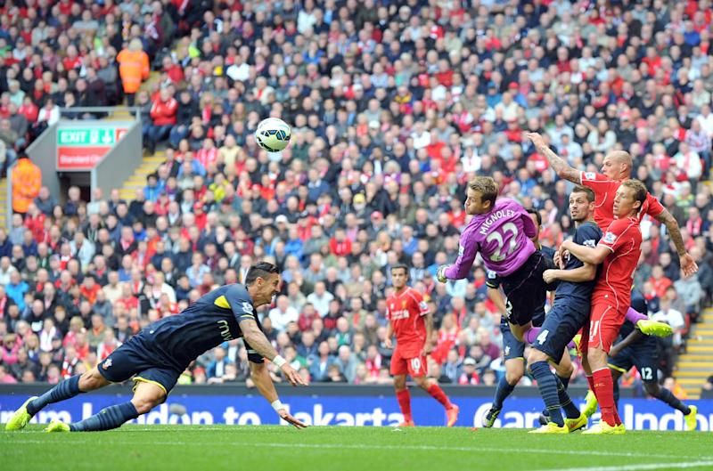 Liverpool goalkeeper Simon Mignolet (4th R) saves a shot by Southampton at Anfield stadium in Liverpool on August 17, 2014 (AFP Photo/Paul Ellis)