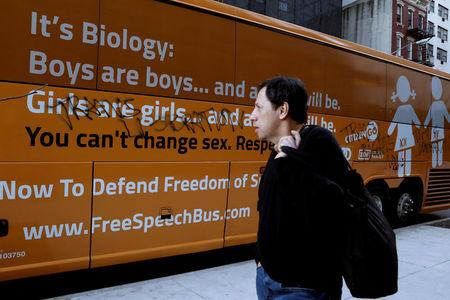 """FILE PHOTO: A man looks at the damage to the """"Free Speech Bus,"""" after it was attacked near the United Nations Headquarters in New York City, U.S., March 23, 2017. REUTERS/Brendan McDermid/File Photo"""