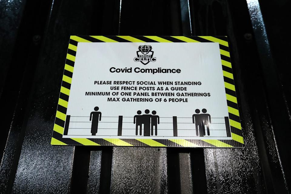FARSLEY, ENGLAND - OCTOBER 13: A general view of a sign encouraging social distancing inside the stadium during the FA Cup Third Qualifying Round match between Farsley Celtic and AFC Fylde at The Citadel stadium on October 13, 2020 in Farsley, England. Sporting stadiums around the UK remain under strict restrictions due to the Coronavirus Pandemic as Government social distancing laws prohibit fans inside venues resulting in games being played behind closed doors. (Photo by George Wood/Getty Images)