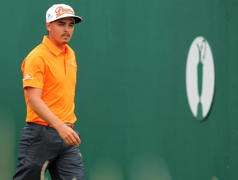 US golfer Rickie Fowler leaves the 1st tee during his fourth round, on the final day of the 2014 British Open Golf Championship at Royal Liverpool Golf Course in Hoylake, north west England on July 20, 2014