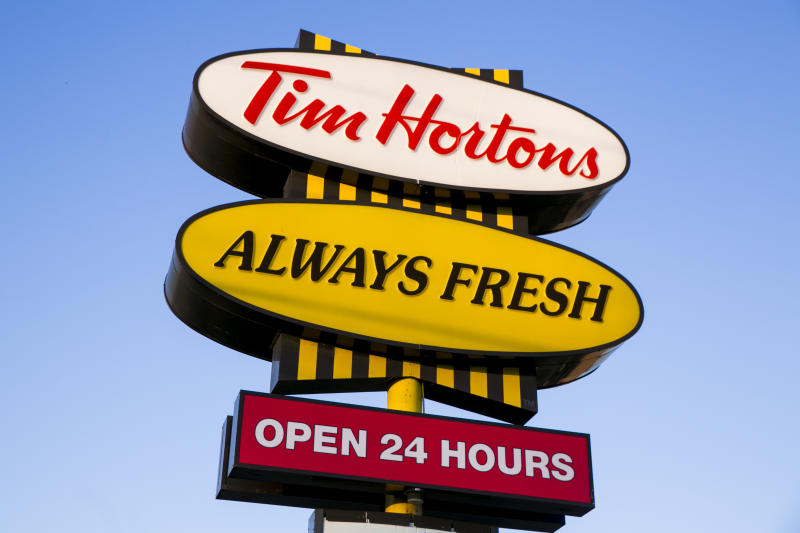 A logo sign outside of a Tim Hortons restaurant in Oakville, ON, Canada on April 14, 2017. Photo by Kristoffer Tripplaar *** Please Use Credit from Credit Field ***