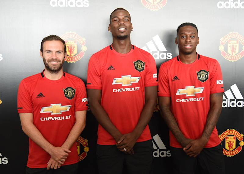 (From left) Manchester United's Juan Mata, Paul Pogba and Aaron Wan-Bissaka attending a fans' meet-and-greet event by adidas at The Float@Marina Bay. (PHOTO: Zainal Yahya/Yahoo News Singapore)