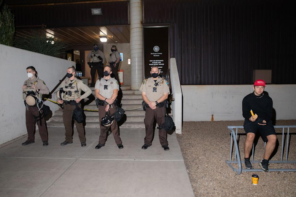 """Law enforcement guard the Maricopa County Elections office in Phoenix, Ariz., on Nov. 4<span class=""""copyright"""">Sinna Nasseri for TIME</span>"""