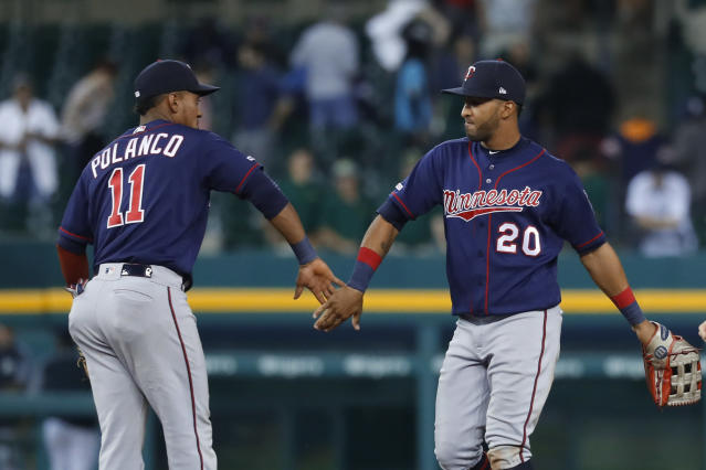 Minnesota Twins' Jorge Polanco (11) and Eddie Rosario (20) celebrate after a baseball game against the Detroit Tigers in Detroit, Tuesday, Sept. 24, 2019. Minnesota won 4-2. (AP Photo/Paul Sancya)