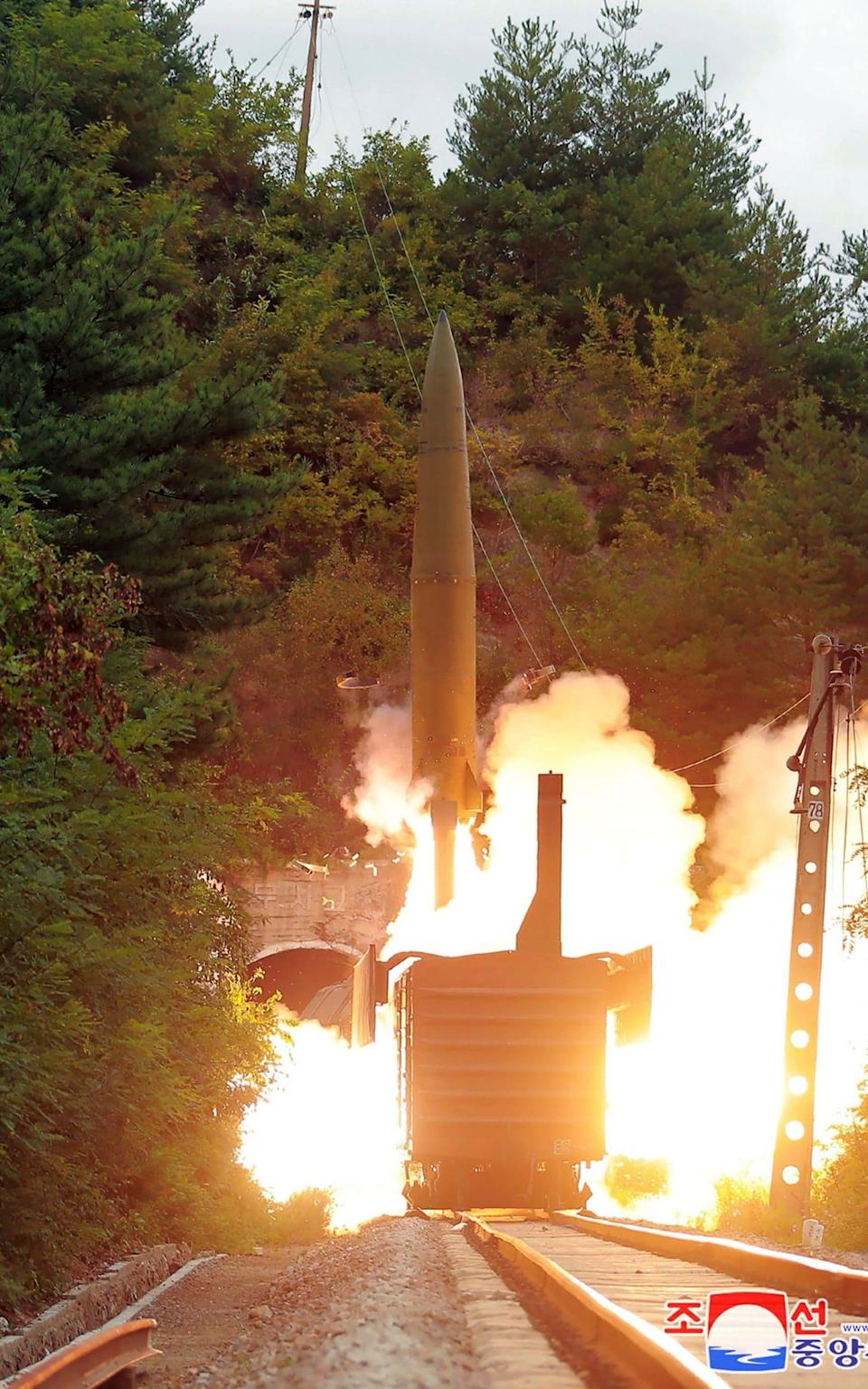 Pictures from the state agency show the missile being launched from the train. - KCNA
