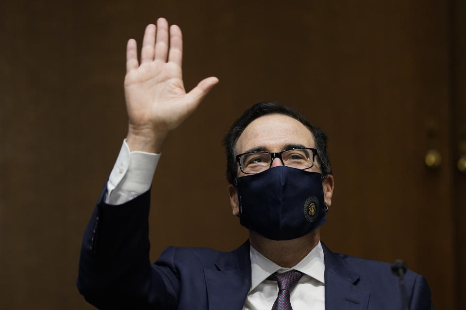 WASHINGTON, DC - SEPTEMBER 24: U.S. Treasury Secretary Steven Mnuchin waves as he arrives for a Senate Banking Committee hearing on Capitol Hill on September 24, 2020 in Washington, DC. Mnuchin and Federal Reserve Board Chairman Jerome Powell are testifying about the CARES Act and the economic effects of the coronavirus (COVID-19) pandemic. (Photo by Drew Angerer/Getty Images)