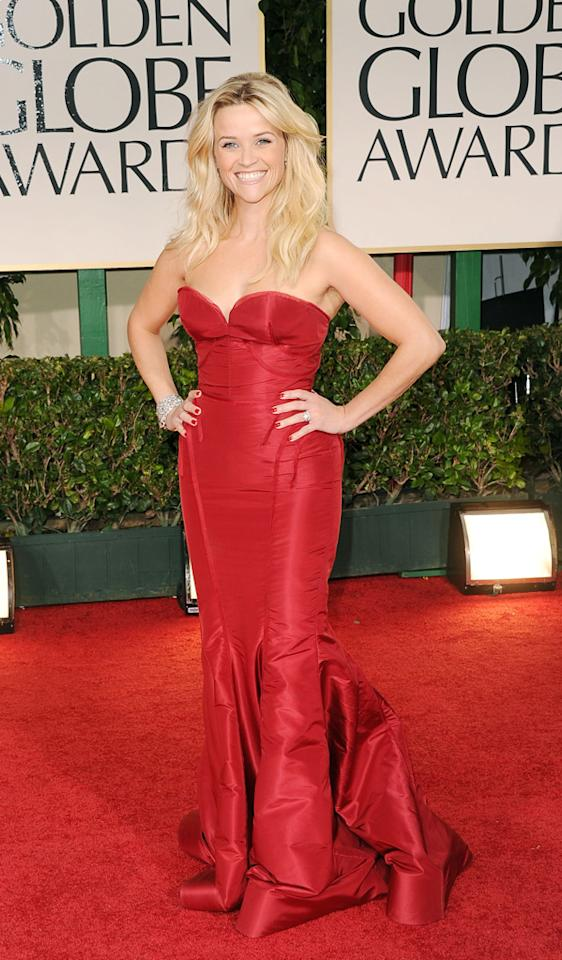 """<strong>Reese Witherspoon</strong><br><strong>Grade: A</strong><br><br><span style=""""font-size:10pt;font-family:Arial;""""> Newlywed Reese Witherspoon heated up the red carpet at the 69th Annual Golden Globe Awards in a sizzling strapless Zac Posen creation. The actress topped off her look with a sparkling diamond bracelet and sexy long tresses.</span>"""