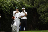 <p>Tiger Woods and his caddie Steve Williams discuss a shot during the third round of the 2008 Masters golf tournament at the Augusta National Golf Club in Augusta, Ga., Saturday, April 12, 2008. (AP Photo/David J. Phillip) </p>