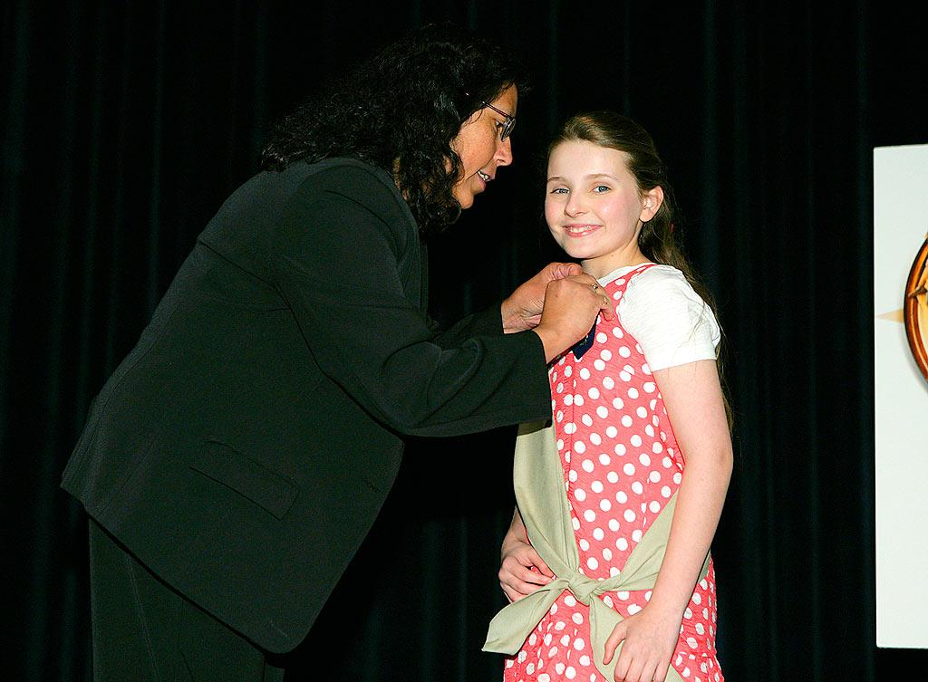 """""""Little Miss Sunshine"""" is all smiles as she gets pinned by Victoria Garcia, Chief Field Service Officer of the Girl Scouts. Todd Williamson/<a href=""""http://www.wireimage.com"""" target=""""new"""">WireImage.com</a> - March 26, 2008"""