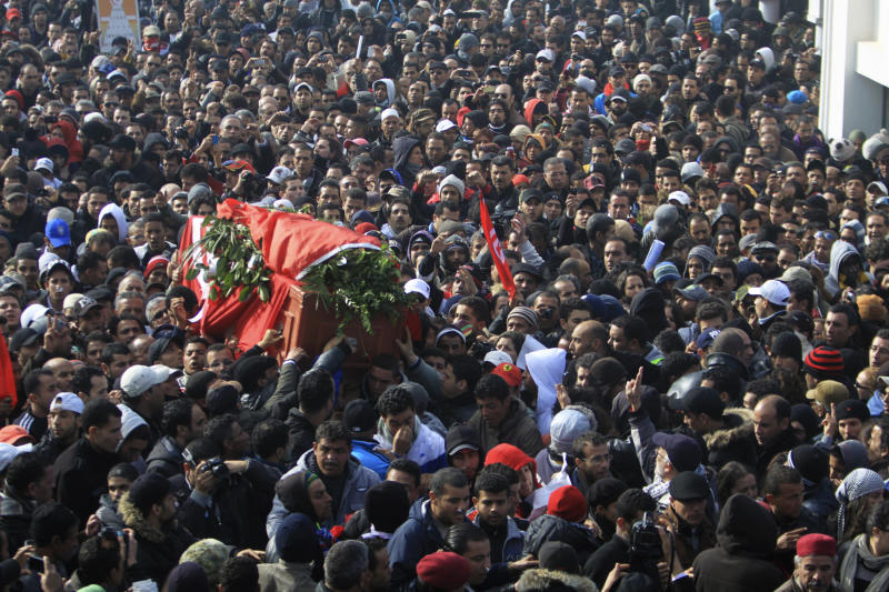Pallbearers carry the coffin of Chokri Belaid as thousands of Tunisians are gathered at el Jallez cemetary to attend the funerals of the slain opposition leader, near Tunis, Friday, Feb. 8, 2013. The Wednesday Feb. 6 assassination of prominent government critic Belaid plunged the country into one of its deepest political crises since the overthrow of the dictatorship in 2011. Watching the events in Tunisia, where a leading anti-Islamist politician was recently assassinated, members of Egypt's liberal opposition are fearfully asking, Could it happen here too? There are reasons for concern: hardline clerics have called for the killing of opposition leaders, and activists say there are worrying signs that show the ruling Islamists are targeting their ranks _ disappearances of activists from protests and telephone death threats. With Islamists convinced the opposition is trying to overthrow President Mohammed Morsi, there is fertile ground for violence. (AP Photo/Str)