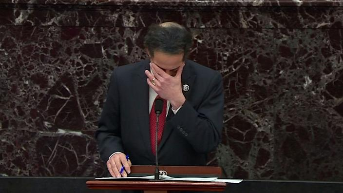 U.S. House lead impeachment manager Rep. Jamie Raskin (D-MD) becomes emotional as he discusses his and his family's experiences inside the U.S. Capitol building during the siege on January 6 and his daughter subsequently telling him that she never wants to return to the building, as Raskin addresses the U.S. Senate at the start of the Senate's second impeachment trial of former U.S. President Donald Trump, on charges of inciting the deadly attack on the U.S. Capitol, on the floor of the Senate chamber on Capitol Hill in Washington, U.S., February 9, 2021. (U.S. Senate TV/Handout via Reuters)
