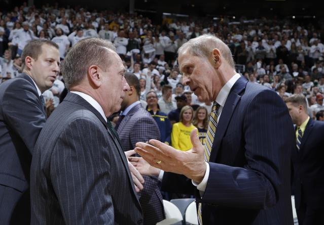 Michigan State coach Tom Izzo, left, meets with Michigan coach John Beilein before an NCAA college basketball game Saturday, March 9, 2019, in East Lansing, Mich. (AP Photo/Al Goldis)