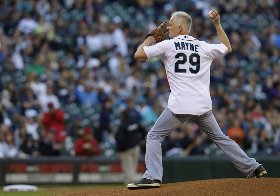 Kenny Mayne throws out the first pitch before a game between the Seattle Mariners and the Angels in September 2014.