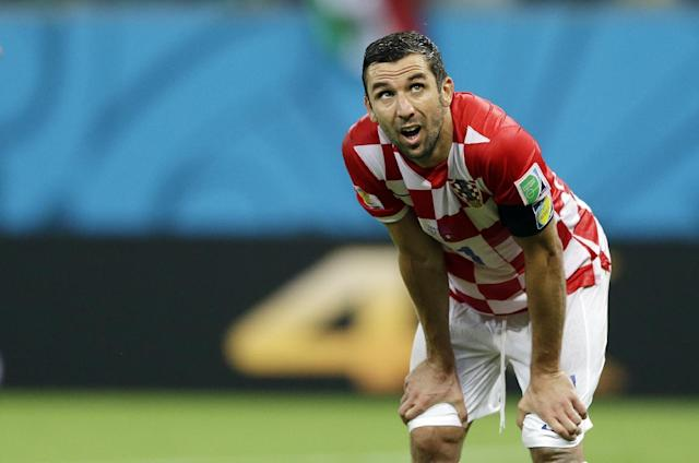 Croatia's Darijo Srna reacts after Mexico scored their second goal during the group A World Cup soccer match between Croatia and Mexico at the Arena Pernambuco in Recife, Brazil, Monday, June 23, 2014. (AP Photo/Ricardo Mazalan)