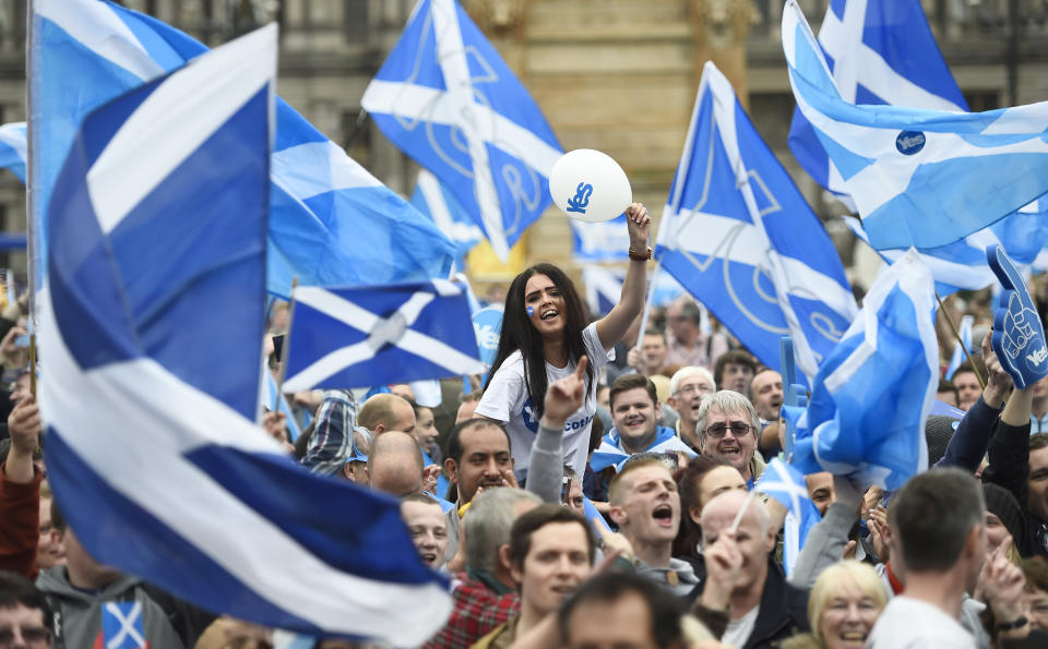 Campaigners wave Scottish Saltires at a 'Yes' campaign rally in Glasgow, Scotland in 2014 during first Scottish referendum. Photo: Dylan Martinez/Reuters
