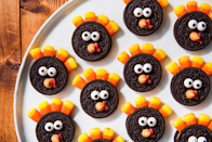 "<p>Milk's favorite cookie gets a Thanksgiving makeover with this recipe. </p><p>Get the recipe from <a href=""https://www.delish.com/cooking/recipe-ideas/a23678576/oreo-turkeys-recipe/"" rel=""nofollow noopener"" target=""_blank"" data-ylk=""slk:Delish"" class=""link rapid-noclick-resp"">Delish</a>.</p><p><a class=""link rapid-noclick-resp"" href=""https://www.amazon.com/Sweet-Sugarbelle-Sprinkles-Kit-Eyeballs-Supplies/dp/B076FDSPGV/?tag=syn-yahoo-20&ascsubtag=%5Bartid%7C1782.g.33808794%5Bsrc%7Cyahoo-us"" rel=""nofollow noopener"" target=""_blank"" data-ylk=""slk:BUY NOW"">BUY NOW</a> <em><strong>Edible eye decorations, $7.99</strong></em><br></p>"
