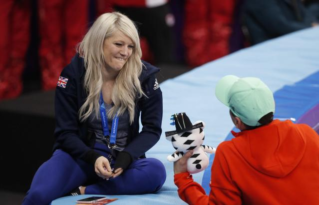 Short Track Speed Skating Events - Pyeongchang 2018 Winter Olympics - Men's 5000m Relay Final - Gangneung Ice Arena - Gangneung, South Korea - February 22, 2018 - Elise Christie of Britain speaks with Shaolin Sandor Liu of Hungary after Hungary's team won gold. REUTERS/John Sibley