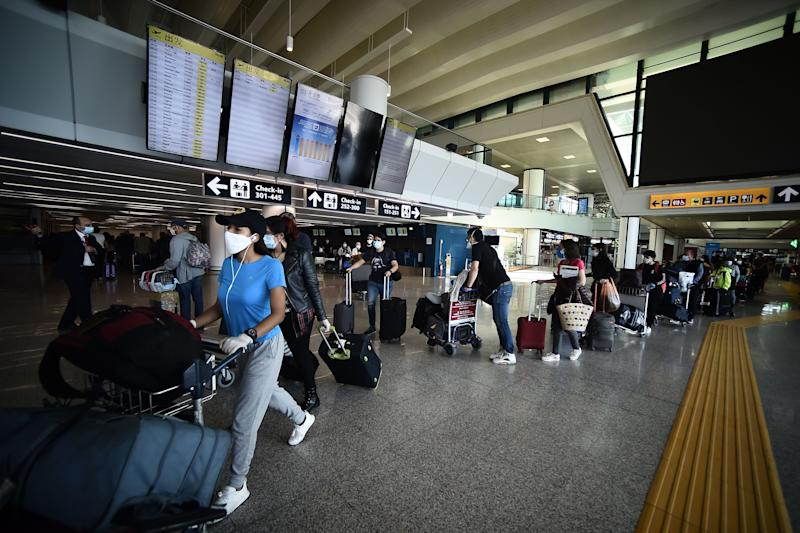 Travelers walk across a terminal at Rome's Fiumicino airport on June 3, 2020, as airports and borders reopen for tourists and residents free to travel across the country, within the COVID-19 infection, caused by the novel coronavirus. (Photo by Filippo MONTEFORTE / AFP) (Photo by FILIPPO MONTEFORTE/AFP via Getty Images) (Photo: FILIPPO MONTEFORTE via Getty Images)