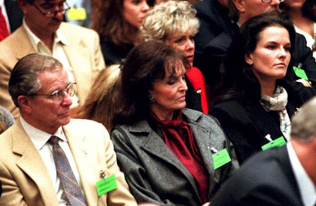 <p>Family members of murder victims Nicole Brown-Simpson and Ronald Goldman listen to court proceedings in the O.J. Simpson double-murder case on Jan. 23,1995, in Los Angeles, Calif. Shown (L-R): Nicole's father Louis Brown, mother Juditha, sister Denise and Goldman's stepmother Patti and father Fred Goldman (behind Juditha). (Photo: Rick Meyer/AFP/Getty Images) </p>
