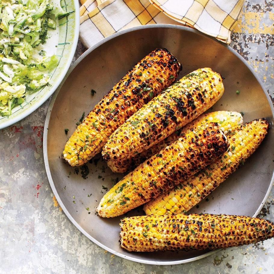 """Flavorful herb butter is the secret to making grilled corn taste even better. (If you're looking for more <a href=""""https://www.epicurious.com/recipes-menus/best-corn-recipes-cob-soup-salad-gallery?mbid=synd_yahoo_rss"""" rel=""""nofollow noopener"""" target=""""_blank"""" data-ylk=""""slk:corn recipes"""" class=""""link rapid-noclick-resp"""">corn recipes</a>, we've got those too.) <a href=""""https://www.epicurious.com/recipes/food/views/grilled-corn-with-herb-butter-51179080?mbid=synd_yahoo_rss"""" rel=""""nofollow noopener"""" target=""""_blank"""" data-ylk=""""slk:See recipe."""" class=""""link rapid-noclick-resp"""">See recipe.</a>"""