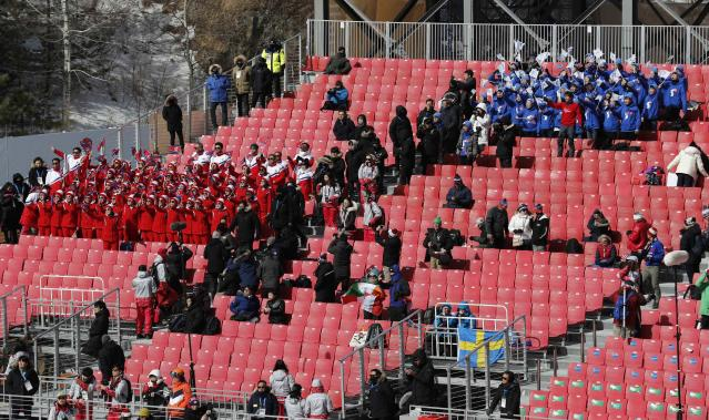 Alpine Skiing – Pyeongchang 2018 Winter Olympics – Women's Slalom – Yongpyong Alpine Centre - Pyeongchang, South Korea – February 16, 2018 - North Korean and South Korean cheerleaders are seen in the stands. REUTERS/Jorge Silva