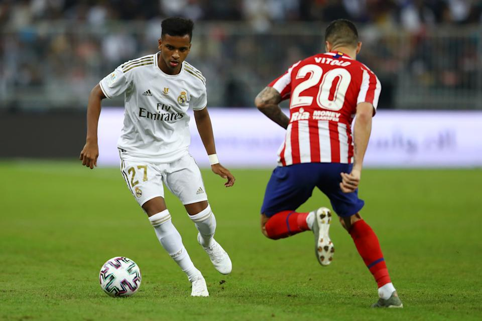 JEDDAH, SAUDI ARABIA - JANUARY 12: Rodrygo of Real Madrid controls the ball as Vitolo of Atletico Madrid looks on during the Supercopa de Espana Final match between Real Madrid and Club Atletico de Madrid at King Abdullah Sports City on January 12, 2020 in Jeddah, Saudi Arabia. (Photo by Francois Nel/Getty Images)