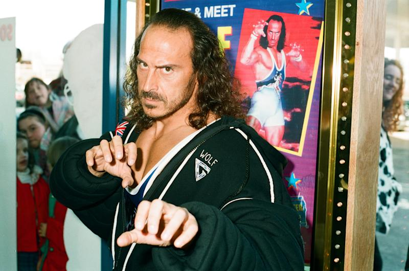 Wolf from Gladiators opening the new Blockbuster Video in Reading, 6th November 1994. (Photo by Staff/Mirrorpix/Getty Images)