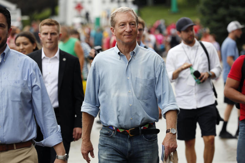 Democratic presidential candidate and businessman Tom Steyer walks down the grand concourse during a visit to the Iowa State Fair, Sunday, Aug. 11, 2019, in Des Moines, Iowa. (AP Photo/Charlie Neibergall)