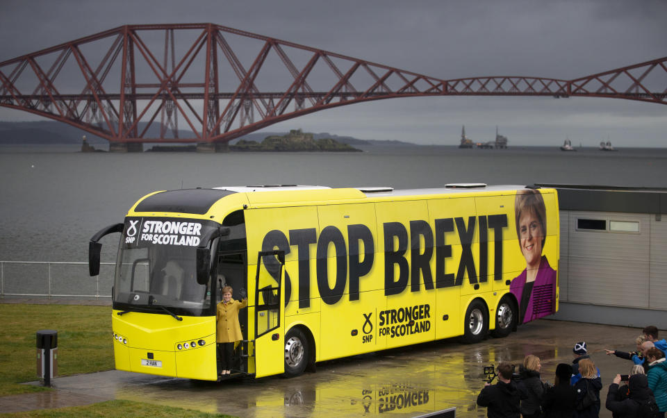 SNP leader Nicola Sturgeon boarding her party's campaign bus (Jane Barlow/PA)