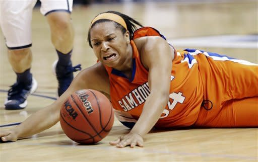 Sam Houston State's Chanice Smith loses the ball after being fouled by Oral Roberts' Kevi Luper during the second half of the Southland Conference NCAA college championship basketball game, Saturday, March 16, 2013, in Katy, Texas. Oral Roberts won 72-66. (AP Photo/David J. Phillip)