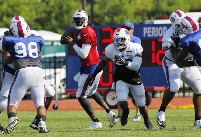 Buffalo Bills quarterback EJ Manuel (3) and running back Fred Jackson (22) run a play during NFL football training camp in Pittsford, N.Y., Tuesday, July 22, 2014. (AP Photo/Bill Wippert)