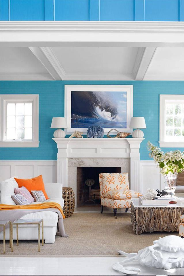 <p>Classic white wainscoting and a vibrant blue wallcovering by Elitis breathe life into this Hamptons living room. <br></p>