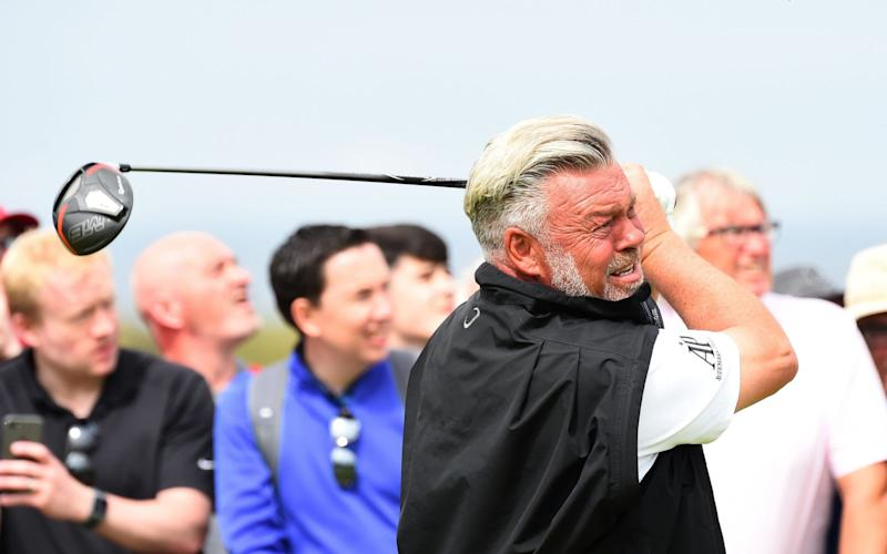 Darren Clarke wasso distraught that he immediately walked straight off the course without speaking to the media - AFP