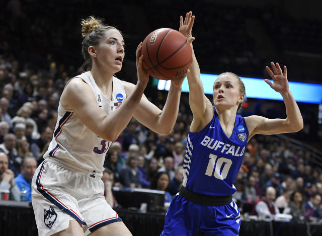 Connecticut's Katie Lou Samuelson (33) looks to shoot as Buffalo's Hanna Hall (10) defends during the first half of a second-round women's college basketball game in the NCAA tournament, Sunday, March 24, 2019, in Storrs, Conn. (AP Photo/Jessica Hill)