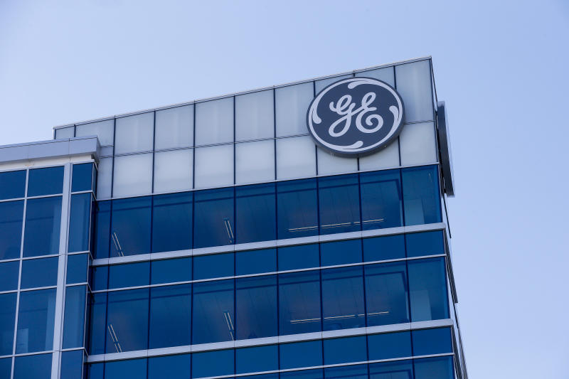 FILE - In this Jan. 16, 2018 file photo, the General Electric logo is displayed at the top of their Global Operations Center in the Banks development of downtown Cincinnati. General Electric says it will sell its biopharma business to Danaher Corp. for $21.4 billion as the former industrial giant continues to shrink itself. The biopharma unit was part of GE Life Sciences and had revenues of about $3 billion last year. The mostly-cash transaction is expected to close in the fourth quarter of this year. (AP Photo/John Minchillo, File)